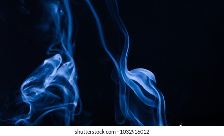 Abstract Smoke Photography Dark Blue Color using incense stick highlighted in flash light 020
