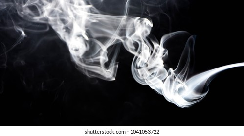 Abstract Smoke white on black background. explosive powder white on black background.