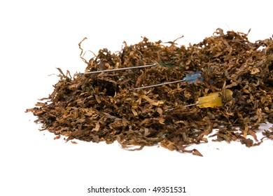 Abstract Smoking Addiction concept of pile of shredded tobacco with hypodermic needle.