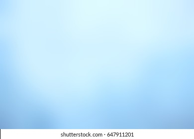 Abstract snow blank background. Pale blue winter blurred background. Frosty airy texture. Background light blue winter.