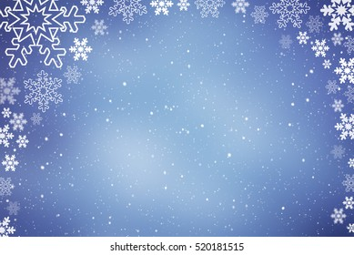 Abstract snowflake Christmas winter background with copy space. Falling snow on blue background
