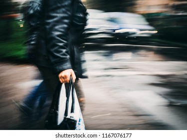 Abstract soft focus image of a group of people crossing the street at a crosswalk. Intentional motion blur and color shift