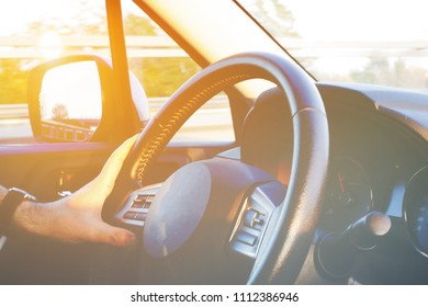 Abstract soft focus of person driving car, image of people driving car for background usage take photo from inside, vintage filter background.