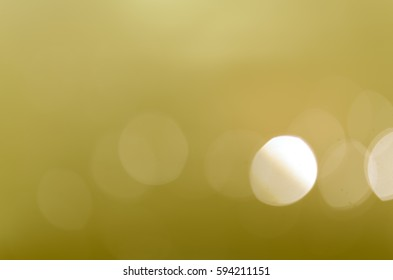 Abstract Soft Light Gold Bokeh Background.