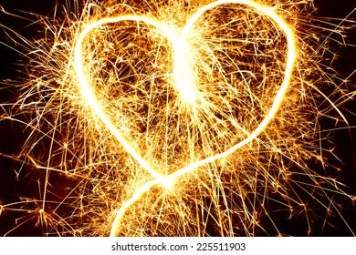 Abstract sparkler motion heart shape texture.