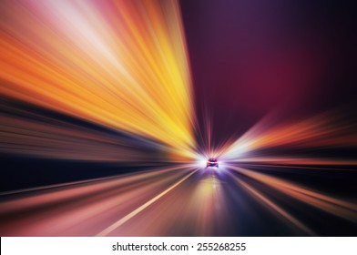 Abstract  of a speed blurred motion in an urban road .