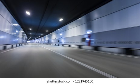 Abstract speed motion in urban highway road tunnel. Motion blur background. Empty road location