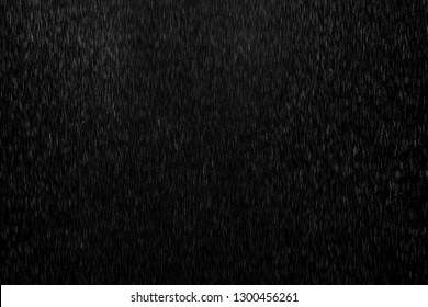 Abstract splashes of Rain and Snow Overlay Freeze motion of white particles on black background