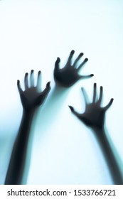 Abstract and spooky defocused hand