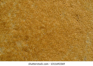 abstract spotty and porous organic texture of grain pastries closeup for a background or for wallpaper of natural color