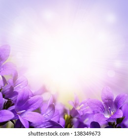 Abstract spring background with purple flowers