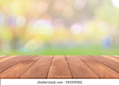 Abstract spring or summer with sunlight background and wood table