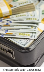 Abstract Stacks of Newly Designed U.S. One Hundred Dollar Bills in Briefcase.