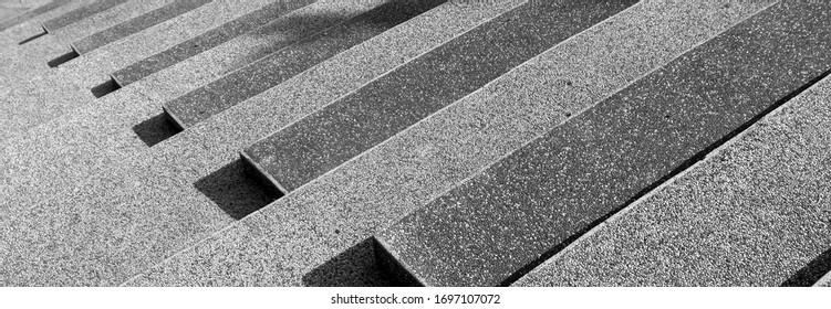 Abstract stairs in black and white, abstract steps, stairs in the city, granite stairs, often stone stairs seen on monuments and landmarks(Black and white photo)