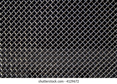 Abstract steel grid from car radiator. Black background