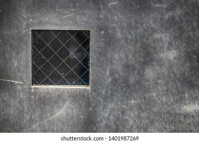 Abstract steel plate with small window in daylight
