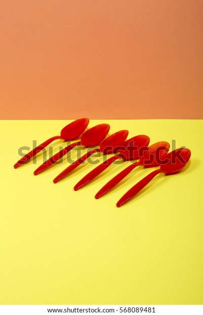 Abstract still life with a teaspoon on a colorful background
