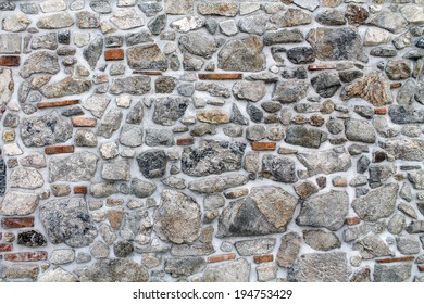 Abstract stonework background texture with old weathered dark stucco black paint stone cement wall in rural room Grungy cold rock surface in hard grime empty place with red specks granite light floor