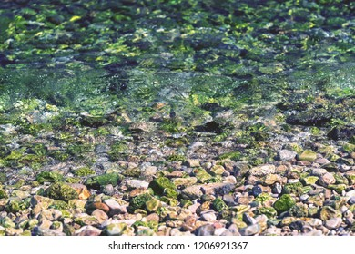 abstract stony texture closeup on an indistinct background of a sea surf for a natural landscape background