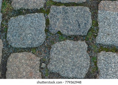 Abstract  street background of old natural stone pavement close-up.