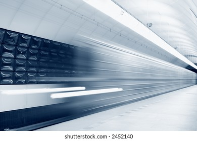 An abstract subway train blured in motion, toned