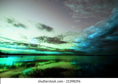 Abstract sunset in green, blue, grey