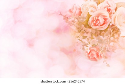 Abstract. Sweet color roses in bokeh texture soft blur for background with pastel vintage retro style.