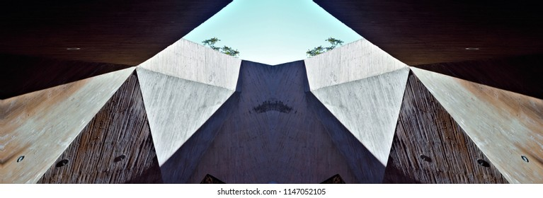 abstract symmetrical and panoramic photograph of a wall with entrances and edges, roof of the entrance to the escalators of Toledo, spain,