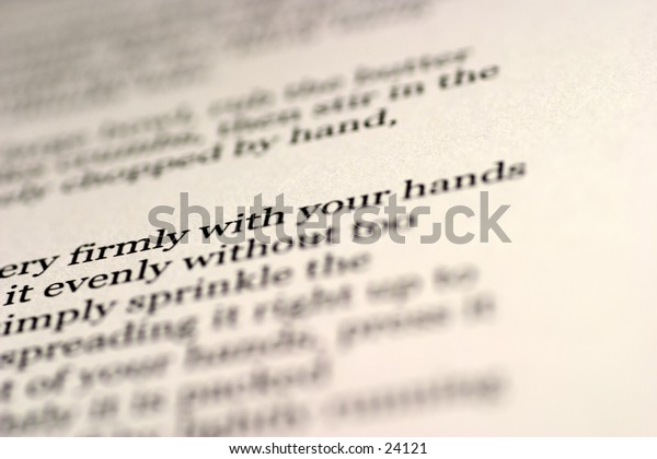 Abstract of text on a page. Narrow depth of field.