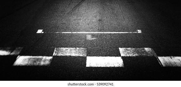 Abstract texture and background asphalt street road with start and finish line and car tire skid mark, Automobile and automotive formula F1 concept.
