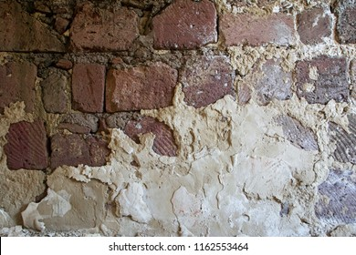 Abstract texture background of tuff stone wall with damaged putty on it in an abandoned house. Devastation concept