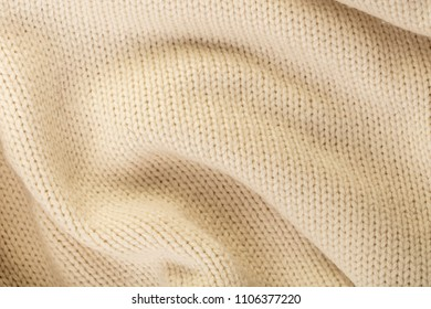 abstract texture background woolen knitted fabric close-up