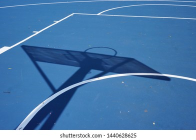 Abstract and texture of basket ball field during mid day.