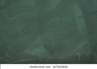 Abstract texture of chalk rubbed out on green blackboard or chalkboard background. School education, dark wall backdrop or learning concept.