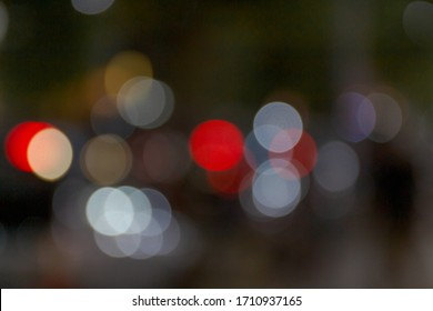 Abstract texture in cities - blurred background with bokeh lighting at night on the street