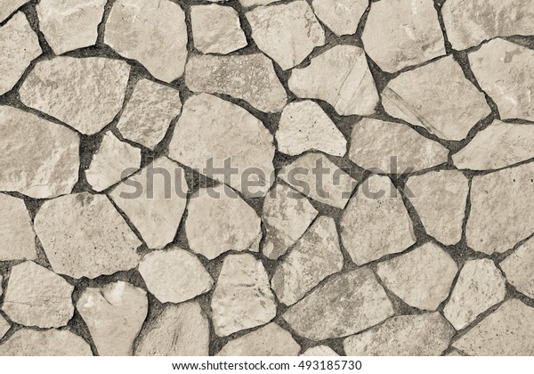 abstract texture of a facing stone of beige color for a background or for wallpaper