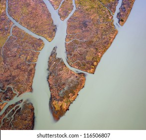 abstract texture -Fraser River sediment and green water