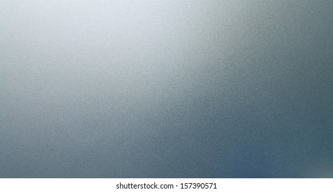 Abstract texture of grey and light blue smooth brushed metal background
