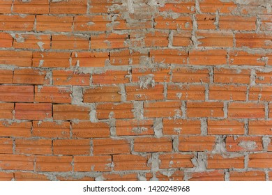 Abstract Texture grungy Background of Brown Brick wall.