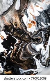 Abstract texture. Modern artwork. Marble effect painting. Mixed black and white paints. Golden paint. Unusual trendy background for poster, card, invitation. Contemporary art.