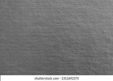 abstract texture of paper or other material with stamping closeup for a fashionable background or for wallpaper of gray color