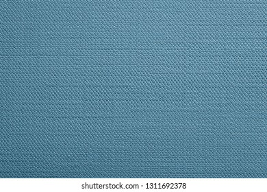abstract texture of paper or other material with stamping closeup for a fashionable background or for wallpaper of pale blue color
