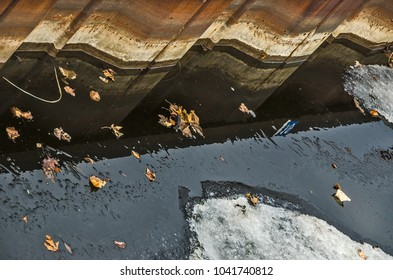 Abstract with texture, water, ice, rust, leaves, and reflections