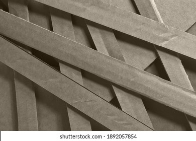Abstract textured background in beige color with wavy lines.Corrugated board top view, there is free space. Close-up of corrugated board for packaging.