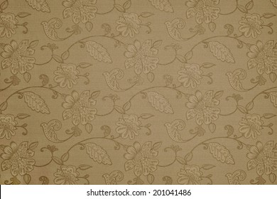 the abstract textured background of beige color with flower patterns