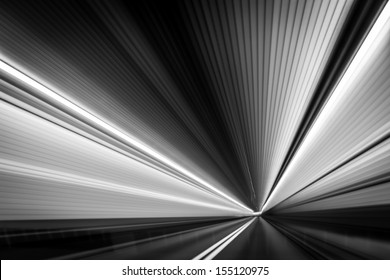 Abstract  time-warp  photo taken from a moving car inside a tunnel.