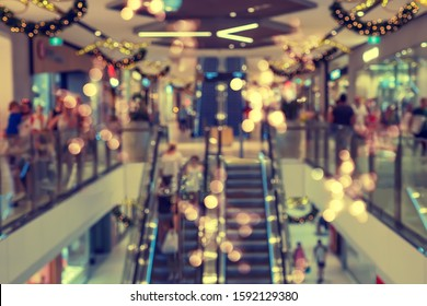 Abstract toned blurred shopping mall of department store interior with Christmas decorations for background