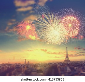 Abstract travel background: fireworks over Eiffel tower in Paris, France. Vintage colored picture
