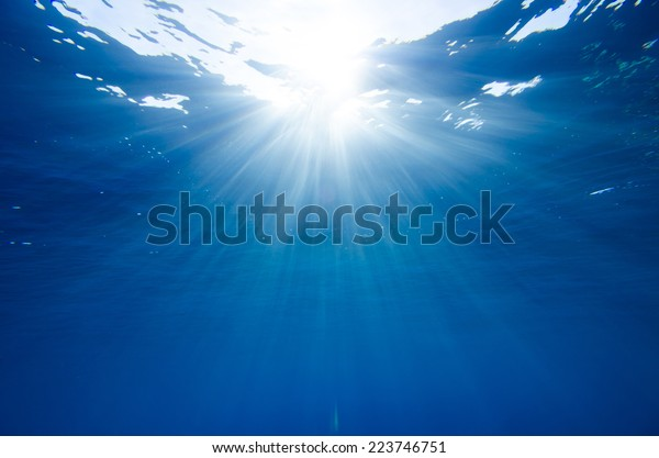Abstract underwater background with sun rays