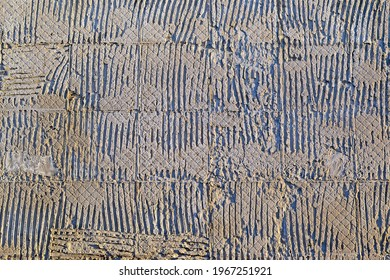abstract uneven embossed textured concrete wall, stone material texture closeup diversity